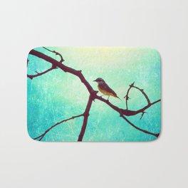 The Bird (Textured blue sky and little bird in a branch tree) Bath Mat