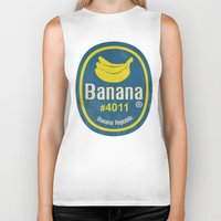 sticker Biker Tanks featuring Banana Sticker On Yellow by Karolis Butenas