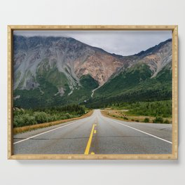 View of the Richardson Highway near Delta Junction Alaska. Empty road in the middle of the highway. Serving Tray