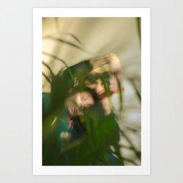 Blurred woman and man behind plants, dancers, romance Art Print