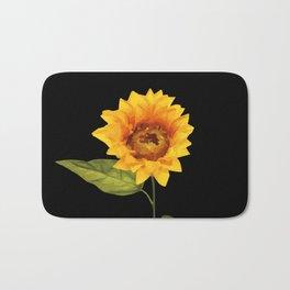 one big yellow Sunflower Blossom - black background Bath Mat