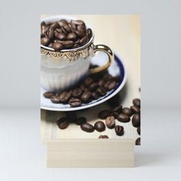 Coffee beans in the old cappuccino cup Mini Art Print