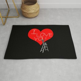 A Man Worker Stands On A Step Ladder And Chisels I Love You In Red Heart. Black Background Rug