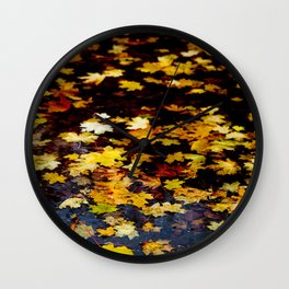 Autumn Leaves in water Wall Clock
