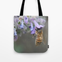 Bee Pollinating Headfirst into Purple Flowers Tote Bag