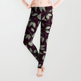 Watercolour leaves pattern on a Burgundy textured background Leggings