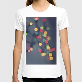 Blurred background with multicolored lights of garland T-shirt