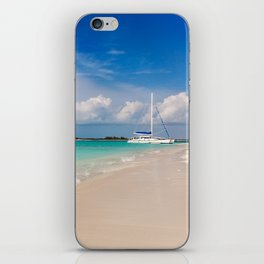 Catamaran on deserted white sand beach iPhone Skin