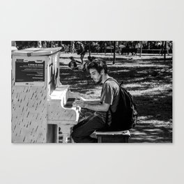 Piano player in the Parc Canvas Print