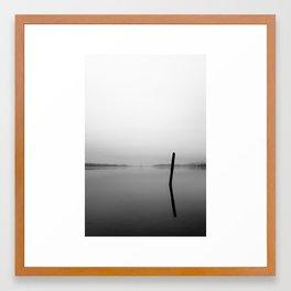 Lone piling in the fog Framed Art Print