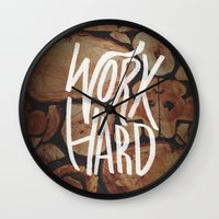 work hard Wall Clocks featuring Work Hard by Leah Flores