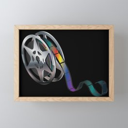 Movie reel with colorful tape Framed Mini Art Print