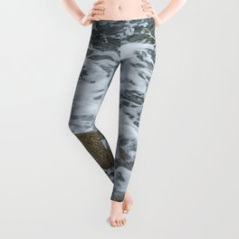 Wave washing over pebbles Leggings