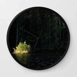 Small island in sunlight at lake shore Wall Clock