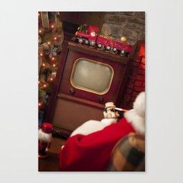 Santa Claus at home watching his vintage TV Canvas Print