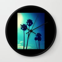 palm trees Wall Clocks featuring Palm Trees by Derek Fleener