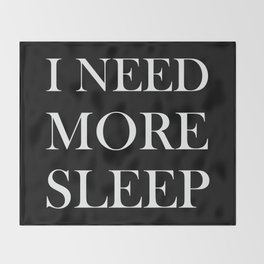 I NEED MORE SLEEP black Throw Blanket