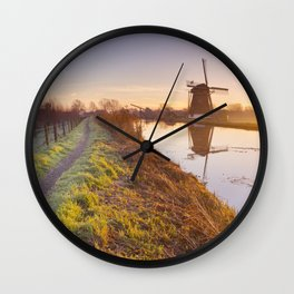 Traditional Dutch windmill near Abcoude, The Netherlands at sunrise Wall Clock