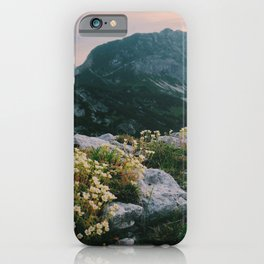 Mountain flowers at sunrise iPhone Case