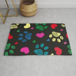 Doodle colorful paw prints with hearts seamless fabric design pattern vector black background Rug