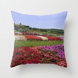 Floral patchwork under a blue sky Throw Pillow
