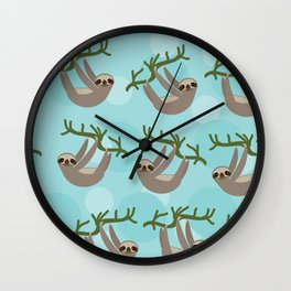 Three-toed sloth on green branch blue background Wall Clock