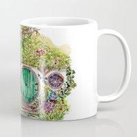 the hobbit Mugs featuring Hobbit hole by Kris-Tea Books