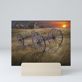 Farm Wagon Chassis in a Grassy Field on a Mid West Farm at Sunset Mini Art Print