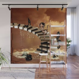 Cute little girl dancing on a piano Wall Mural