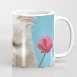 A cat holding a flower Coffee Mug