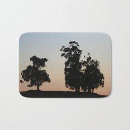 Eucalyptus trees at sunset Bath Mat