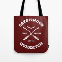 gryffindor Tote Bags featuring Gryffindor Quidditch by Sharayah Mitchell