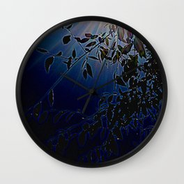 blue light and leaves Wall Clock