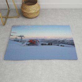 Morning animal of ski resort: Snowcat at work Rug