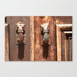Antique wooden door with hand knockers Canvas Print