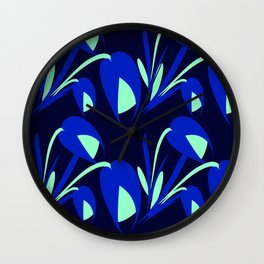 Vibrant flowers and blue tulips on a black background. Wall Clock