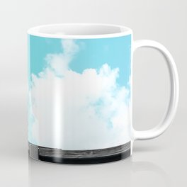 electric pole with wooden wall and blue cloudy sky in the city Coffee Mug