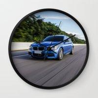 bmw Wall Clocks featuring BMW M135i by Nenhum Destes