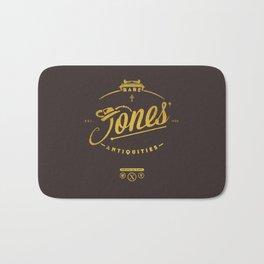 """""""Jones' Rare Antiquities"""" - gold version Bath Mat"""