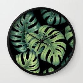 Monstera botanical leaves illustration pattern on black Wall Clock