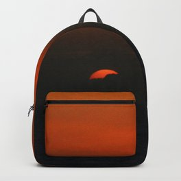 cloudy sunset seascape Backpack