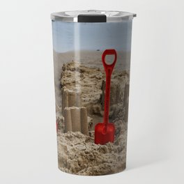 sandcastles and red spades on the beach Travel Mug