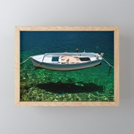 Boat floats on crystal clear water Framed Mini Art Print