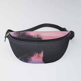 Reflection of a pink sunset in a ditch in an rural area Fanny Pack