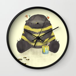 Dark chocolate bear imitating a bee on vanilla background Wall Clock