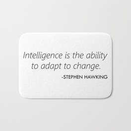 Intelligence is the ability to adapt to change. Bath Mat