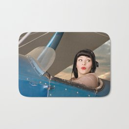 """""""Plucky Pilot"""" - The Playful Pinup - Pilot Pin-up Girl in Airplane by Maxwell H. Johnson Bath Mat"""