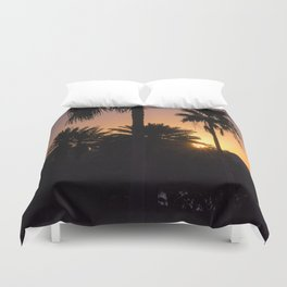 Backlight with palm trees Duvet Cover