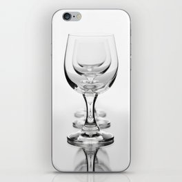 Three empty wine glasses in a row iPhone Skin