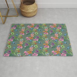 Floral pattern, plants and hummingbirds on green background Rug
